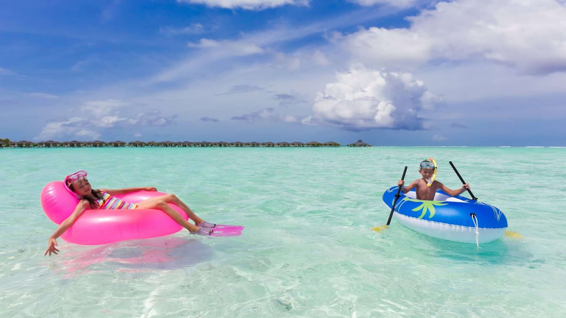Teaching a child to the water in the Maldives
